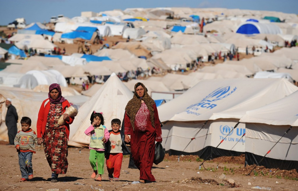 As a result of this horrific violence, about 7.6 million Syrians have been internally displaced — stuck in Syria, but forced out of their homes. These people often live in crowded and underfunded camps, like the Atme camp on the Turkish border, pictured above in 2013. (Bulent Kilic/AFP/Getty Images)